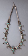 American Indian Art:Jewelry and Silverwork, A ZUNI SILVER AND TURQUOISE SQUASH BLOSSOM NECKLACE...