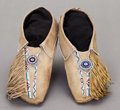 American Indian Art:Beadwork and Quillwork, A PAIR OF COMANCHE BEADED HIDE MOCCASINS. c. 1890...