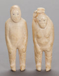 American Indian Art:Wood Sculpture, A PAIR OF ESKIMO CARVED IVORY FIGURES. c.1900...