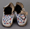 American Indian Art:Beadwork and Quillwork, A PAIR OF SIOUX CHILD'S BEADED HIDE MOCCASINS...