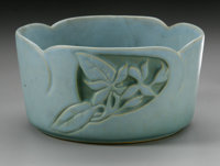 AN AMERICAN ART POTTERY BOWL Roseville Pottery, designed c.1952  The turquoise bowl in the 'Silhouette' pattern depictin...