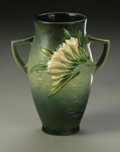 Ceramics & Porcelain, American:Modern  (1900 1949)  , AN AMERICAN POTTERY VASE. Roseville, designed 1945. Of 'Freesia'pattern, the shaped body with attached handles and molded...