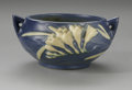 Ceramics & Porcelain, American:Modern  (1900 1949)  , AN AMERICAN ART POTTERY BOWL. Roseville, designed 1945. Of'Freesia' pattern, the double handled bowl depicting white and ...