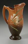 Ceramics & Porcelain, American:Modern  (1900 1949)  , AN AMERICAN POTTERY VASE. Roseville, designed 1945. In 'Freesia'pattern, the bulbous cylindrical form on circular foot, w...