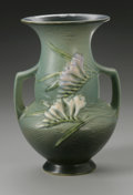 Ceramics & Porcelain, American:Modern  (1900 1949)  , AN AMERICAN POTTERY VASE. Roseville, designed 1945. Of 'Freesia'pattern, the shaped bulbous body with attached handles an...