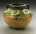 Ceramics & Porcelain, American:Modern  (1900 1949)  , AN AMERICAN POTTERY JARDINIERE. Roseville, designed c.1924-28. In'Dahlrose' pattern, the baluster form with applied handl...