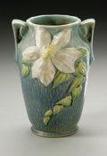 Ceramics & Porcelain, American:Modern  (1900 1949)  , AN AMERICAN POTTERY VASE. Roseville, designed 1944-1945. Of'Clematis' pattern, the baluster form with applied handles mol...