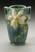 Ceramics & Porcelain, American:Modern  (1900 1949)  , AN AMERICAN ART POTTERY VASE. Roseville Pottery, designed1944-1945. The double-handled vase in the 'Clematis' pattern, de...