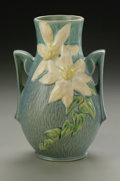 Ceramics & Porcelain, American:Modern  (1900 1949)  , AN AMERICAN POTTERY VASE. Roseville, designed 1944-1945. Of'Clematis' pattern, the baluster vase with applied handles mol...