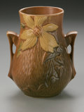 Ceramics & Porcelain, American:Modern  (1900 1949)  , AN AMERICAN ART POTTERY VASE. Roseville, designed 1944-1945. Of'Clematis' pattern, the bulbous body with applied handles ...