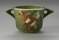 Ceramics & Porcelain, American:Modern  (1900 1949)  , AN AMERICAN ART POTTERY BOWL. Roseville Pottery, designed 1947. Thedouble-handled bowl in the 'Snowberry' pattern, depict...