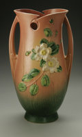 Ceramics & Porcelain, American:Modern  (1900 1949)  , A LARGE AMERICAN POTTERY VASE. Roseville, designed 1940. Of 'WhiteRose' pattern, the shaped elliptical body with handles ...