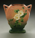 Ceramics & Porcelain, American:Modern  (1900 1949)  , AN AMERICAN POTTERY VASE. Roseville, designed 1940. Of 'White Rose'pattern, the stepped flask shaped body with everted ha...
