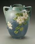 Ceramics & Porcelain, American:Modern  (1900 1949)  , AN AMERICAN POTTERY VASE. Roseville, designed 1940. Of 'White Rose'pattern, the large tapering body with scalloped rim, a...