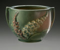 Ceramics & Porcelain, American:Modern  (1900 1949)  , AN AMERICAN ART POTTERY VASE. Roseville, designed 1942. Of'Foxglove' pattern, the tapering cylindrical body with applied ...
