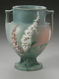 Ceramics & Porcelain, American:Modern  (1900 1949)  , AN AMERICAN POTTERY VASE. Roseville, designed 1942. In 'Foxglove'pattern, the urn form with applied handles, raised on a ...