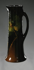 Ceramics & Porcelain, American:Modern  (1900 1949)  , AN AMERICAN ART POTTERY PITCHER. Roseville, Rozane Royal, designedc.1905. The tall cylindrical pitcher in 'Rozane Ware' p...