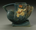 Ceramics & Porcelain, American:Modern  (1900 1949)  , AN AMERICAN POTTERY VASE. Roseville, designed 1943-1944. Of'Magnolia' pattern, the stepped modern body with cream flowers...
