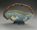 Ceramics & Porcelain, American:Modern  (1900 1949)  , AN AMERICAN POTTERY BASKET. Roseville, designed 1948. Of 'AppleBlossom' pattern, the elliptical body with branch handle a...