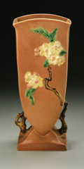 Ceramics & Porcelain, American:Modern  (1900 1949)  , AN AMERICAN POTTERY VASE. Roseville, designed 1948. 'Apple Blossom'pattern, square tapered form raised on a squared foot ...