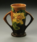 Ceramics & Porcelain, American:Modern  (1900 1949)  , AN AMERICAN POTTERY VASE. Roseville, designed 1943. Of 'Water Lily'pattern, the shaped cylindrical body with large applie...