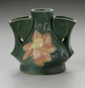 Ceramics & Porcelain, American:Modern  (1900 1949)  , AN AMERICAN ART POTTERY VASE. Roseville. Triple vase form moldedwith a flower in pink and yellow on a matte green glaze g...