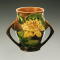 Ceramics & Porcelain, American:Modern  (1900 1949)  , AN AMERICAN POTTERY VASE. Roseville, designed 1943. 'Water Lily'pattern, the bulbous shaped body with attached everted ha...