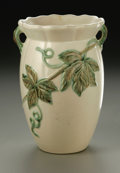 Ceramics & Porcelain, American:Modern  (1900 1949)  , AN AMERICAN POTTERY VASE. Weller, early 20th century. The ovoidform with flared neck and applied handles molded with a gr...