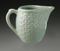 Ceramics & Porcelain, American:Modern  (1900 1949)  , AN AMERICAN POTTERY CREAMER. Weller, c.1930-1948. In 'Pierre'pattern, the small form with applied handle and molded baske...
