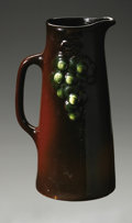 Ceramics & Porcelain, American:Modern  (1900 1949)  , AN AMERICAN POTTERY PITCHER. Weller, designed 1904. Of 'Floretta'pattern, the tall tapering form with applied handle deco...