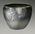 Ceramics & Porcelain, American:Modern  (1900 1949)  , AN AMERICAN POTTERY JARDINIERE. Weller, designed 1906. In 'Etna'pattern, molded with pink roses on a high gloss green gla...