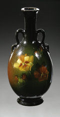 Ceramics & Porcelain, American:Modern  (1900 1949)  , AN AMERICAN POTTERY VASE. McCoy, c.1910. The bottle form vase withapplied handles glazed in brown and green, decorated wi...