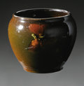 Ceramics & Porcelain, American:Modern  (1900 1949)  , AN AMERICAN POTTERY VASE. McCoy, c.1899-1911. The small jardinièreform decorated with an orange blossom on the high gloss...