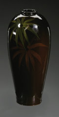 Ceramics & Porcelain, American:Modern  (1900 1949)  , AN AMERICAN ART POTTERY VASE. Cambridge, 1920. The taperingcylindrical body with high glaze decoration with sprays of flo...
