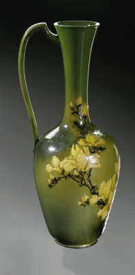 AN AMERICAN POTTERY VASE Rookwood, 1881  The ewer form vase, decorated by Matt A. Daly with slender neck and applied han...