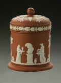 Ceramics & Porcelain, British:Modern  (1900 1949)  , AN ENGLISH CERAMIC JAR AND COVER. Wedgwood, 20th century. Of terracotta and white jasperware, the cylindrical body with c...