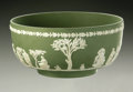 Ceramics & Porcelain, British:Modern  (1900 1949)  , AN ENGLISH CERAMIC BOWL. Wedgwood, 20th century. Of green and whitejasperware, the bowl with relief decoration with class...