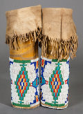 American Indian Art:Beadwork and Quillwork, A PAIR OF SOUTHERN CHEYENNE GIRL'S BEADED HIDE LEGGINGS...