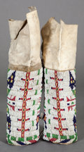 American Indian Art:Beadwork and Quillwork, A PAIR OF SIOUX GIRL'S BEADED HIDE LEGGINGS...