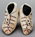 American Indian Art:Beadwork and Quillwork, A PAIR OF APACHE BEADED HIDE MOCCASINS. c. 1890...