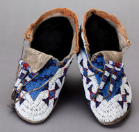 A PAIR OF SIOUX BEADED HIDE MOCCASINS c. 1900