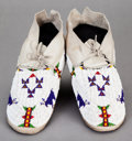 American Indian Art:Beadwork and Quillwork, A PAIR OF CHEYENNE PICTORIAL BEADED HIDE MOCCASINS...