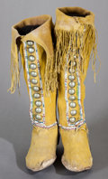 American Indian Art:Beadwork and Quillwork, A PAIR OF COMANCHE WOMAN'S BEADED HIDE BOOT MOCCASINS. c. 1885...