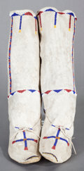American Indian Art:Beadwork and Quillwork, A PAIR OF APACHE WOMAN'S BEADED HIDE BOOT MOCCASINS. c. 1890...