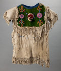 American Indian Art:Beadwork and Quillwork, A PLATEAU GIRL'S BEADED HIDE DRESS...