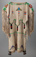 American Indian Art:Beadwork and Quillwork, A KIOWA BEADED HIDE DRESS. c. 1930...