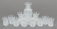 A SET OF TWELVE LALIQUE GLASS ENFANTS LIQUEUR GLASSES, post 1945 Marks: Laliqu