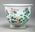 Asian:Chinese, A CHINESE FAMILLE ROSE PORCELAIN FOOTED JARDINIÈRE, . 11-1/4 incheshigh x 14-3/8 inches diameter (28.6 x 36.5 cm). ...