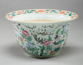 Asian:Chinese, A CHINESE FAMILLE ROSE PORCELAIN JARDINIÈRE. 15-3/4 inches diameter(40.0 cm). ...
