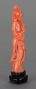 Asian:Chinese, A CHINESE CARVED CORAL FIGURE OF GUANYIN ON CARVED WOOD STAND. 8inches high (20.3 cm). ...
